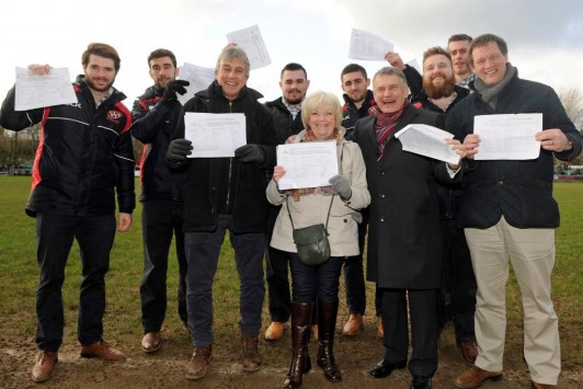 Front row, L-R: Sports presenter John Inverdale (left) with Christine Davison from the Stadium 4 Cornwall Group; Ian Connell, Chairman of The Cornish Pirates and Martin Tucker, director at Penwith College, flanked by team members from the Pirates with petitions of support for the West Langarth development that would fund the Stadium for Cornwall project.