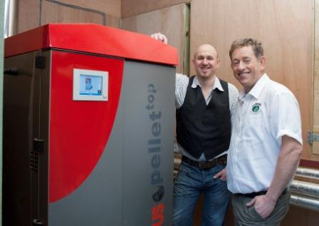 Pendragon Country House owner, Nigel Reed, (l) and Wendron Biomass sales director, Gary Hawkins, pictured with the Pendragon Country House's biomass boiler