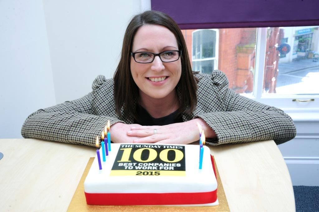 Stephens Scown legal secretary, Sarah Warwick, with a celebratory cake