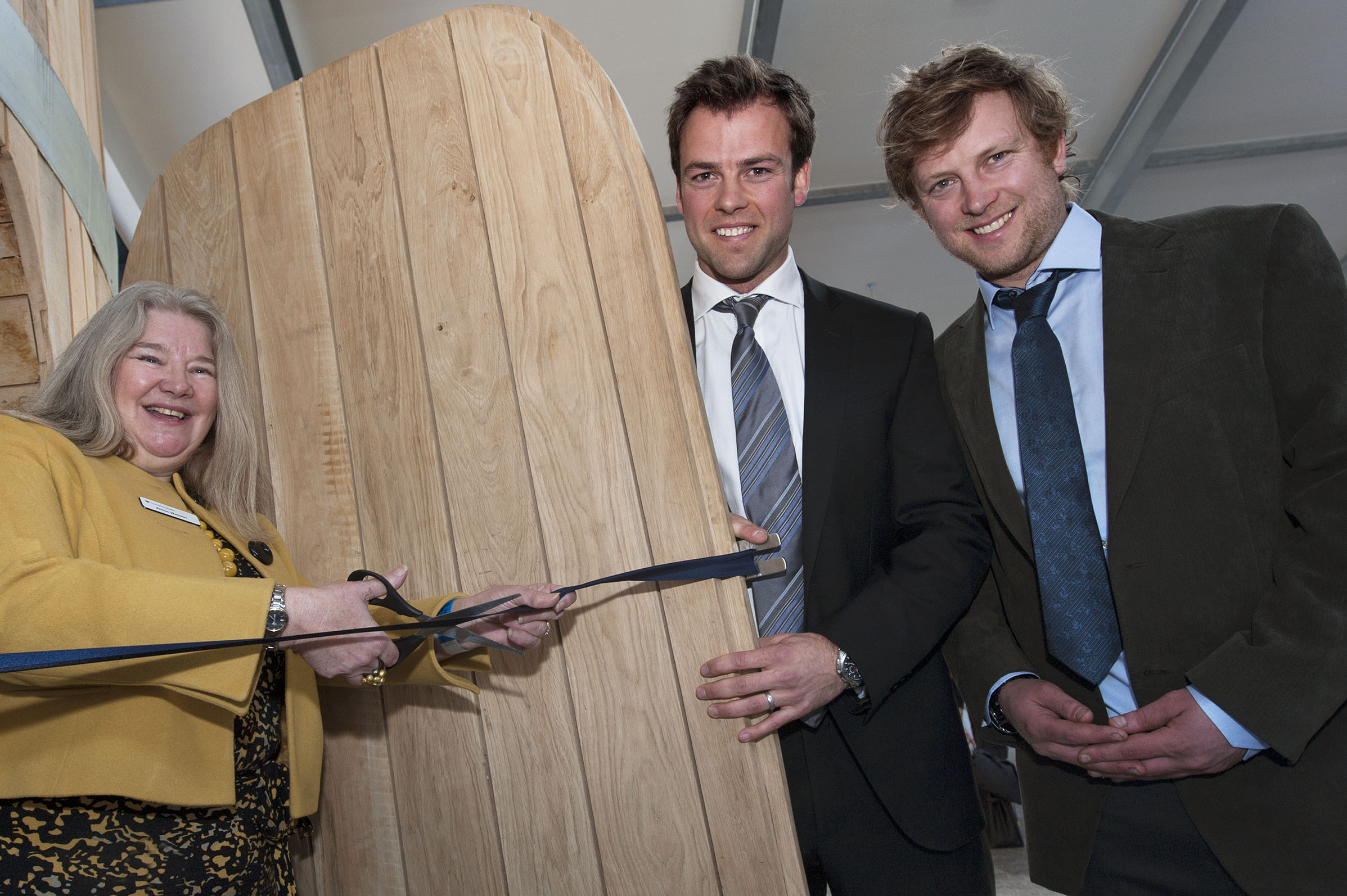 Alison Webster cuts the ribbon with Joe (centre) and Sam Healey