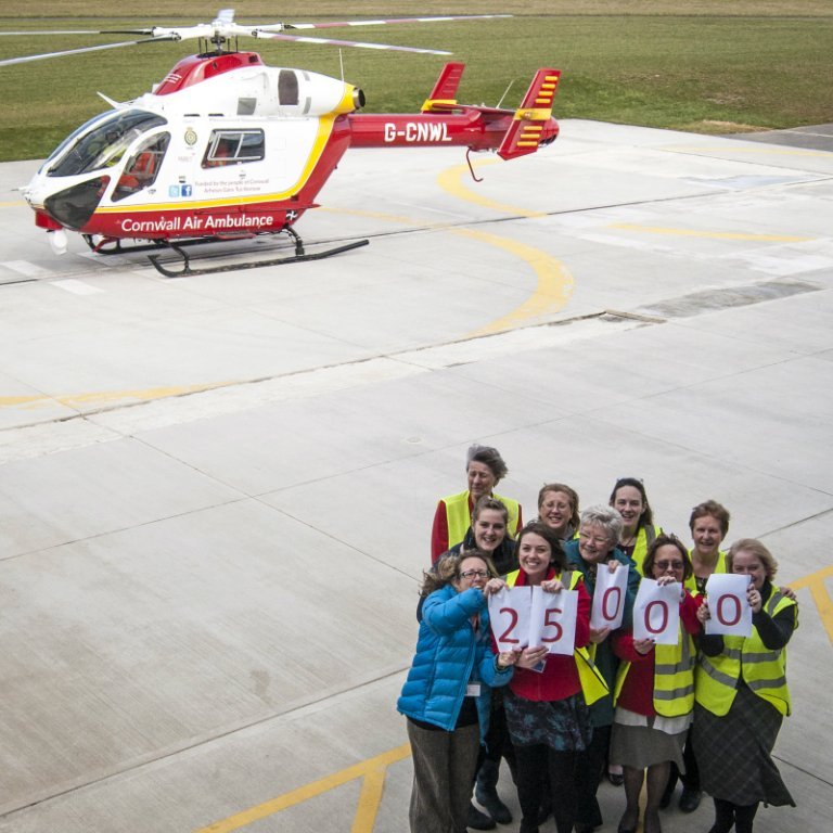 Cornwall Air Ambulance staff and volunteers celebrate as the 25,000th mission takes to the air
