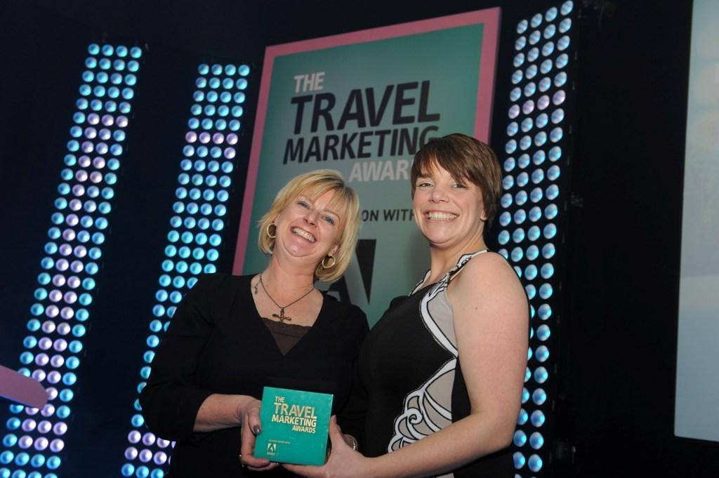 The Eden Project's marketing director Rita Broe (left) and sales manager Claire Quartermaine collect Eden's trophy at the Travel Marketing Awards