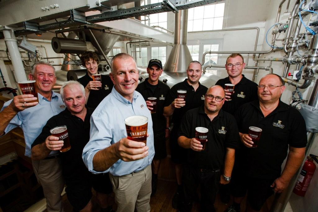 Head brewer Roger Ryman and the brew team raise a glass