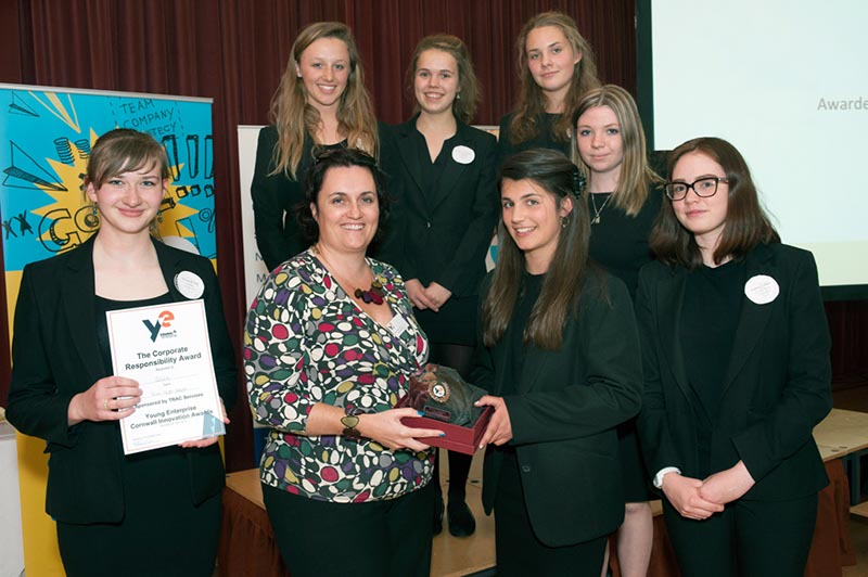 TRAC Services' director, Sarah Trethowan, with the Silvah Upcycle team at this year's Young Enterprise Awards