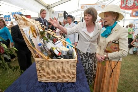 Her Royal Highness being presented a hamper of Cornish food and drink within the Cornwall Food & Farming Pavilion, by organiser Hilary Wood, at the 2009 show