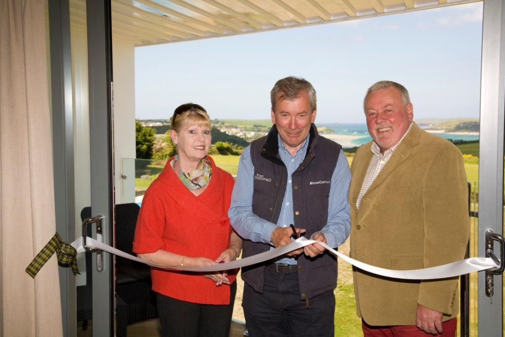 Malcolm Bell (centre) cuts the ribbon with Jenny and Eddie Stanton
