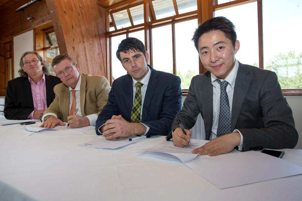 Simon Hume-Kendall, Chief Executive of London Group (second left) and Dr. Peter Zhang, Managing Director of SinoFortone Group (far right) sign the Memorandum of Understanding looked on by Andy Thomson, London Group (far left) and Scott Mann, Conservative MP for North Cornwall (second from right)