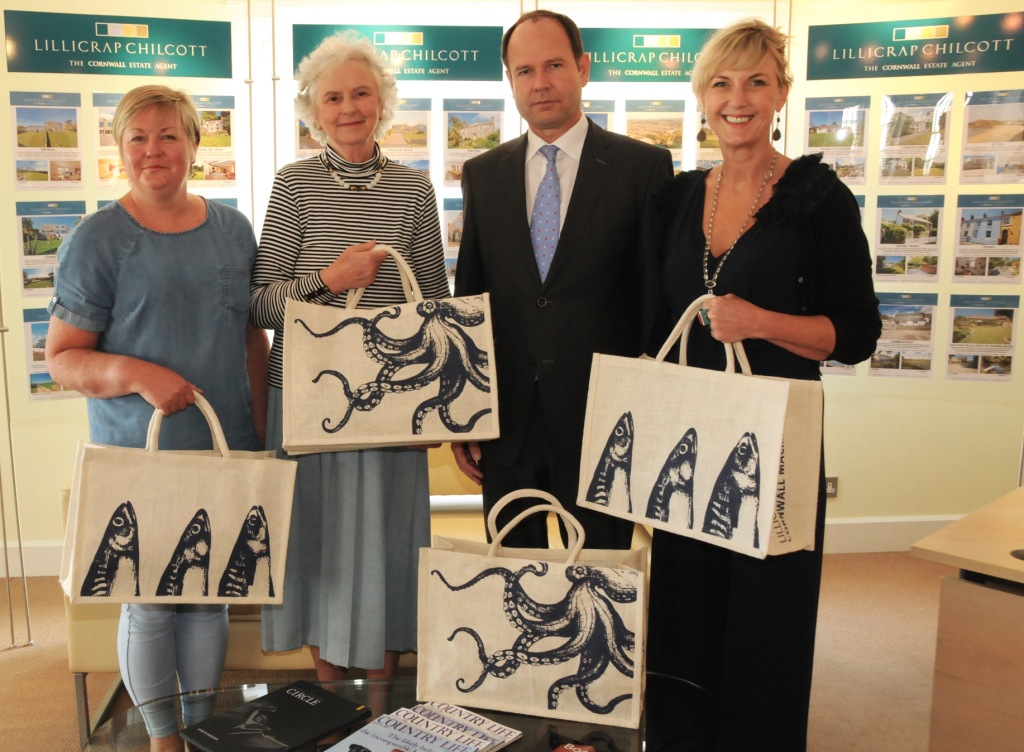 L-R: Pictured with the new limited edition jute shopping bag commissioned for the Cornwall Christmas Macmillan Fair 2015 are: Allison Hughes, Cream Cornwall, Lady Mary Holborow, President of the Cornwall Macmillan Christmas Fair, Ian Lillicrap, Lillicrap Chilcott and Rebecca Heane, Cream Cornwall