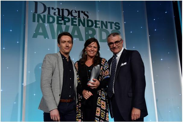 Roo accepting award from Eric Musgrave, Editorial Director of Drapers