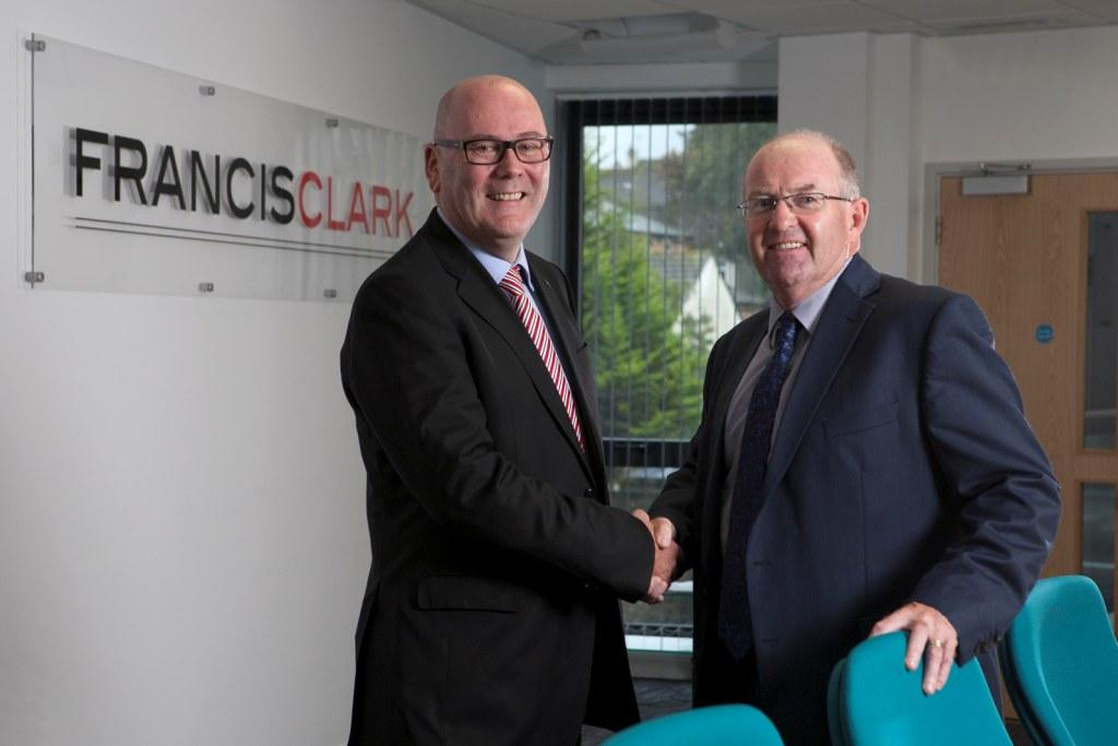Alan Turner (l) welcomes Andrew Newcombe to Francis Clark