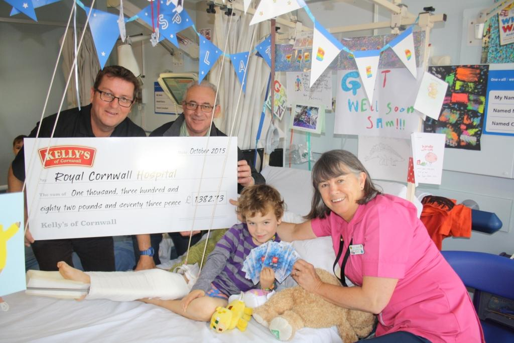 L-R: Graham Kingdon, Kelly's of Cornwall south west territory manager; Paul Harrold, Kelly's of Cornwall factory manager; Samuel Harris, six-year-old patient and Gill Caddy senior hospital play specialist