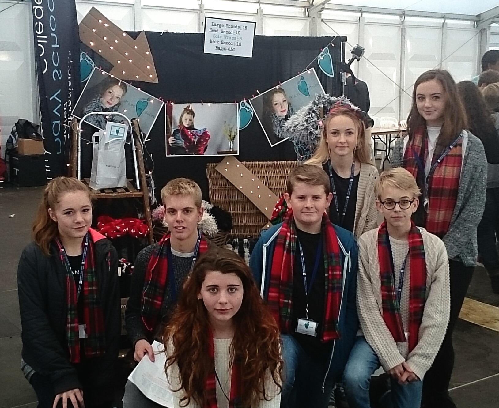 Selling their wraps, snoods and bags at last year's Young Enterprise Christmas Fair is the team from Humphry Davy School, H'Art and Soles.
