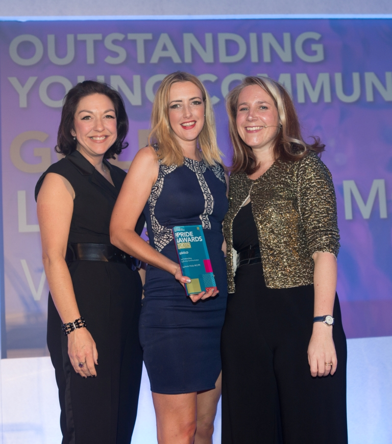Laura Hicks (centre) collects the Outstanding Young Communicator Award