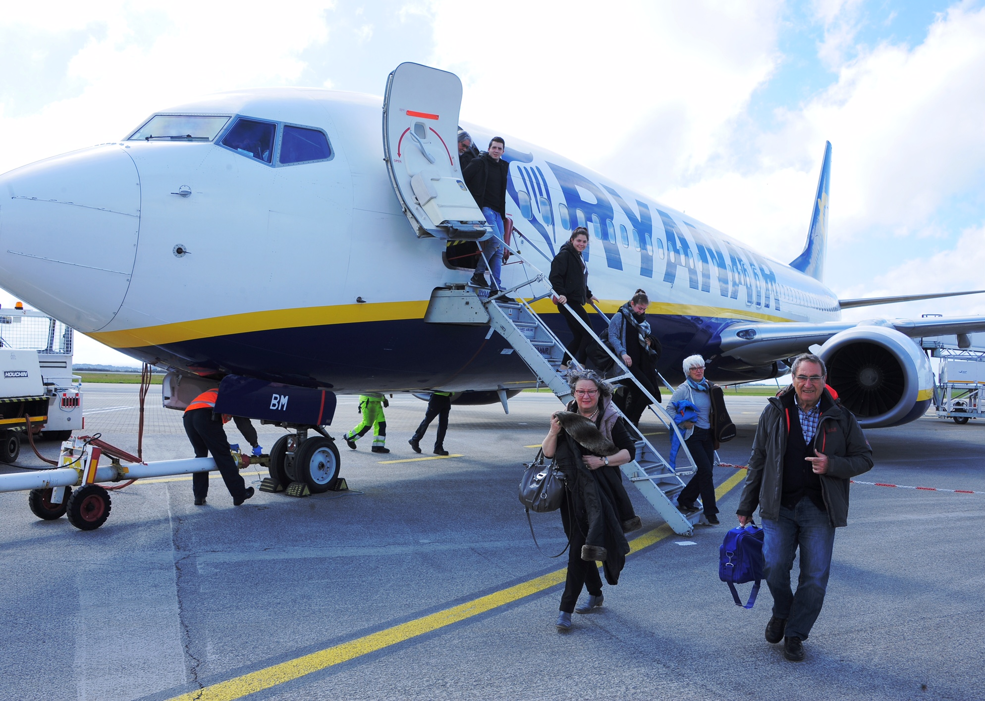The first passengers disembark the Ryanair flight from Frankfurt