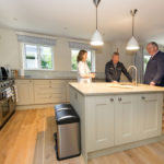 Margaret Langmaid, Malcolm Bell and Patrick Langmaid in one of the house kitchens