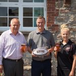 Pirates COO Robin James (l) and Robyn Ashurst (r) celebrate the partnership with Jeremy Mitchell