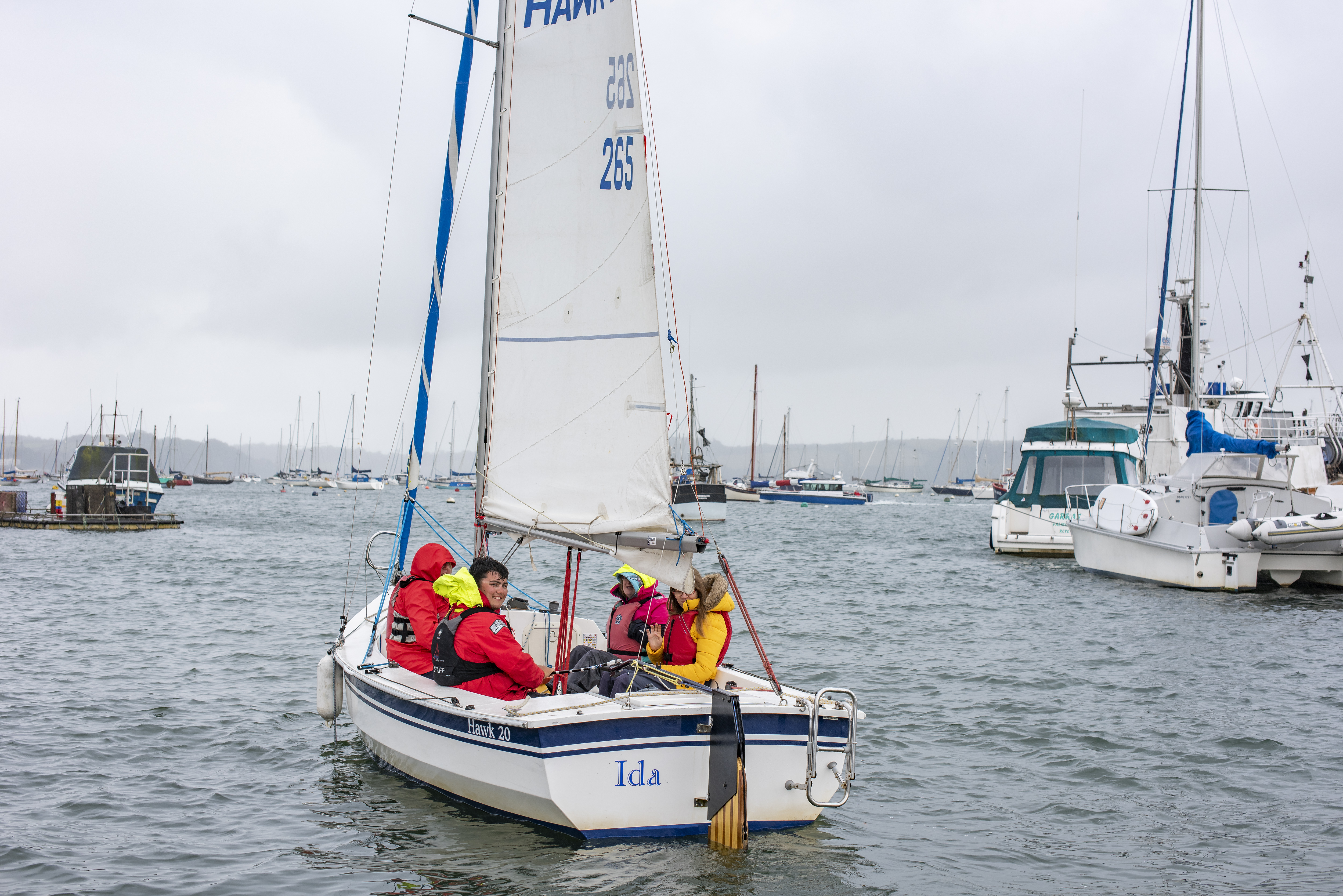 Mylor Sailability Eleanor Moore Ella Perris and instructor Charlie Frost in Hawk 20