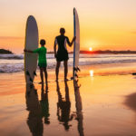 FamilySurfCo_sunset-surfing-family-vacations