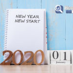 2020 New Year New Start Word On Notebook And Wooden Number. Reso