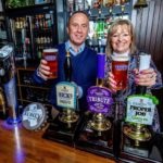 Kevin Georgel, St Austell Brewery's chief executive, with Kim Barker, tenant of The Ship Inn in Pentewan