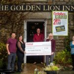 Proprietors Mark Sear and his wife Sarah Sear from The Golden Lion Inn in Menherion, Cornwall, and Bar Manager Belinda Fuller, present a cheque to VIce Chairman Philip Blease and Treasu