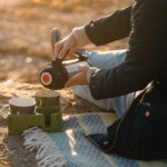 Recycled green muggi on beach with thermos resized72